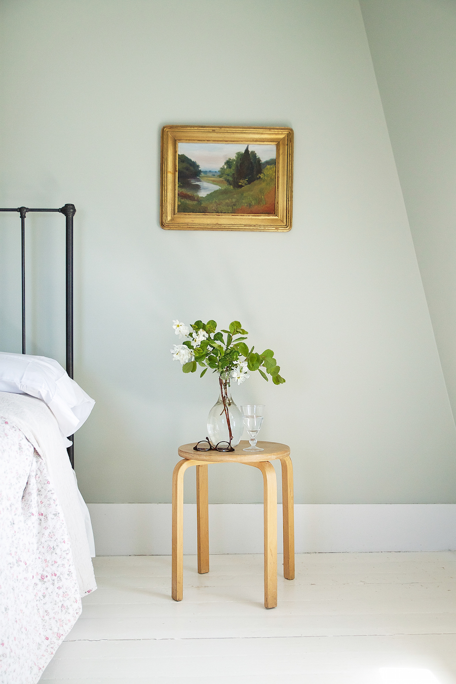 A bedroom in Julie Carlson's Cape Cod cottage painted Cromarty.
