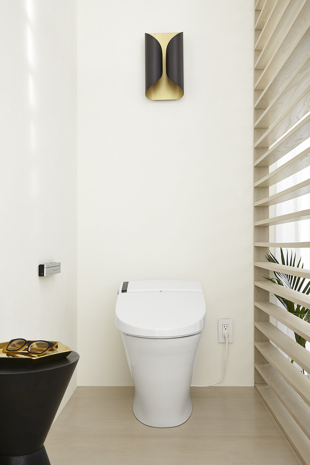 This spectacular piece of technology is a toilet and bidet in one (It also includes an air freshener — not kidding). Meet the  SpaLet AT200 toilet.