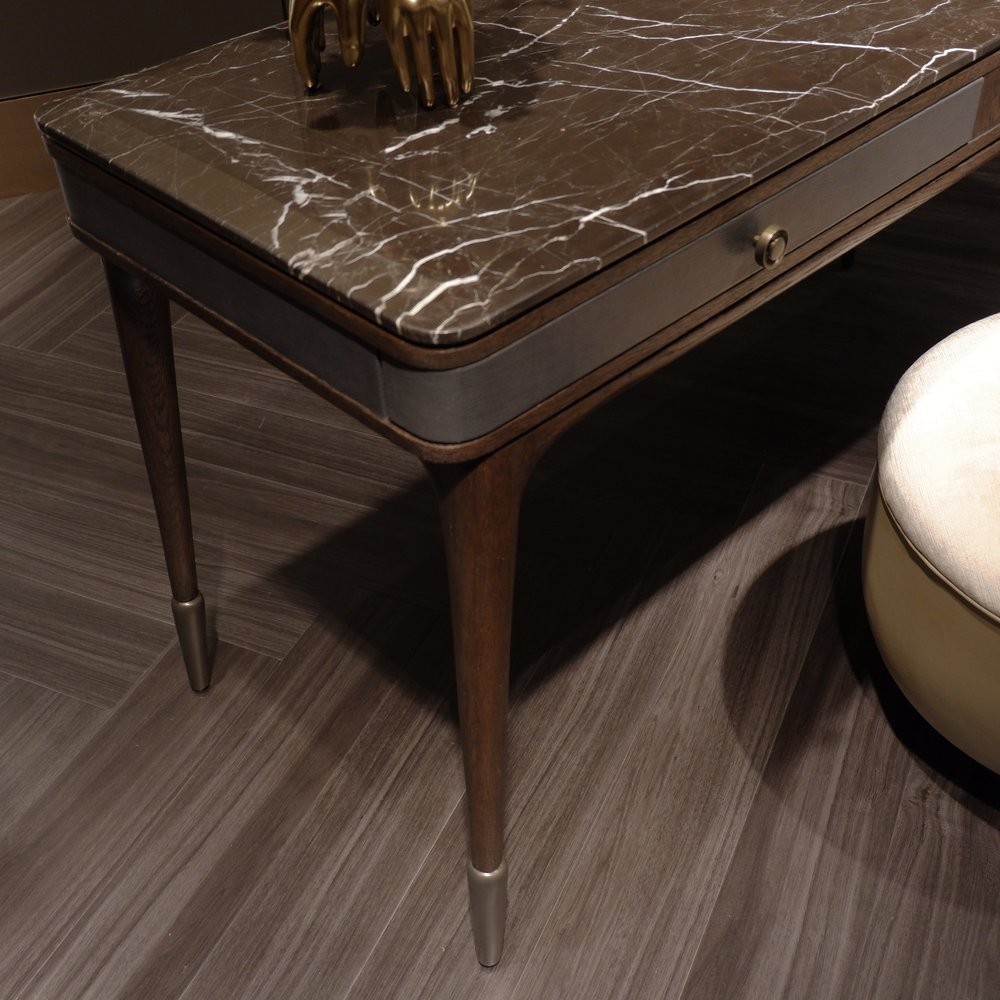 Veined brown marble on a desk by Steve Leung for Theodore Alexander.