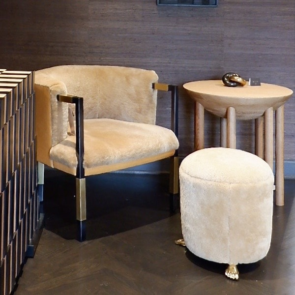A fluffy chair and stool by Kelly Wearstler for E. J. Victor.