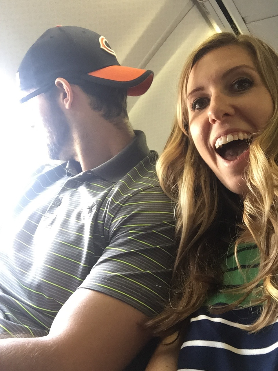 Chauncey refusing to take a picture on the plane