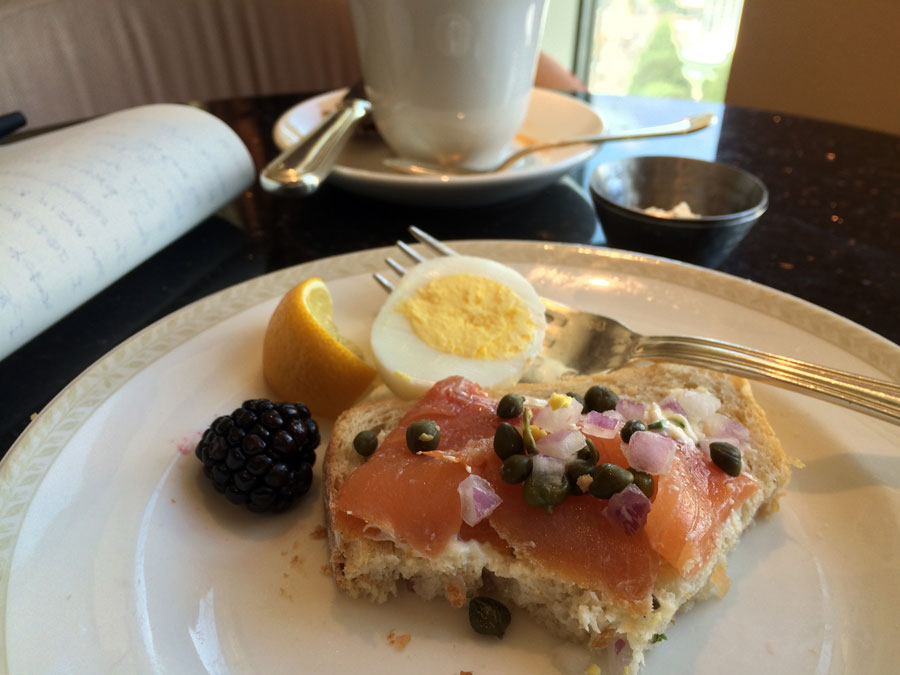 Loungin Breakfast : coffee, salmon with red onions and capers on toast, eggs, blackberries.