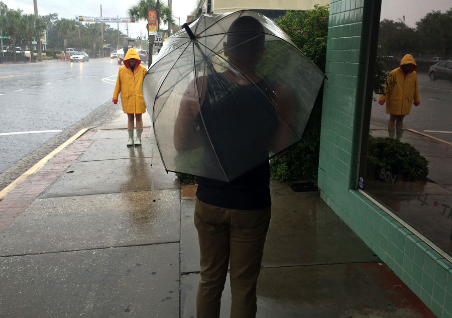 When it rains, it pours. Tierney Lister is geared up and ready for the rain. Mikey Massas prepares to brave the downpour.