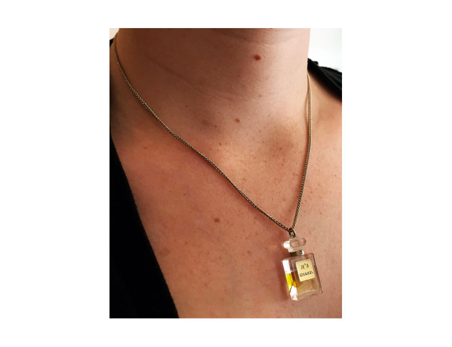 Miniature Chanel No. 5 around your neck and near your <3