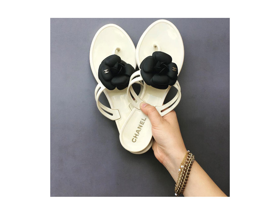 Creme and black jelly sandals with iconic camellia flowers.
