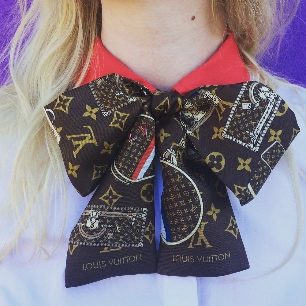 Bow wow.  SIlk Bandeau Twilly Scarf by  Louis Vuitton . Red collar contrast blouse by  Tory Burch .