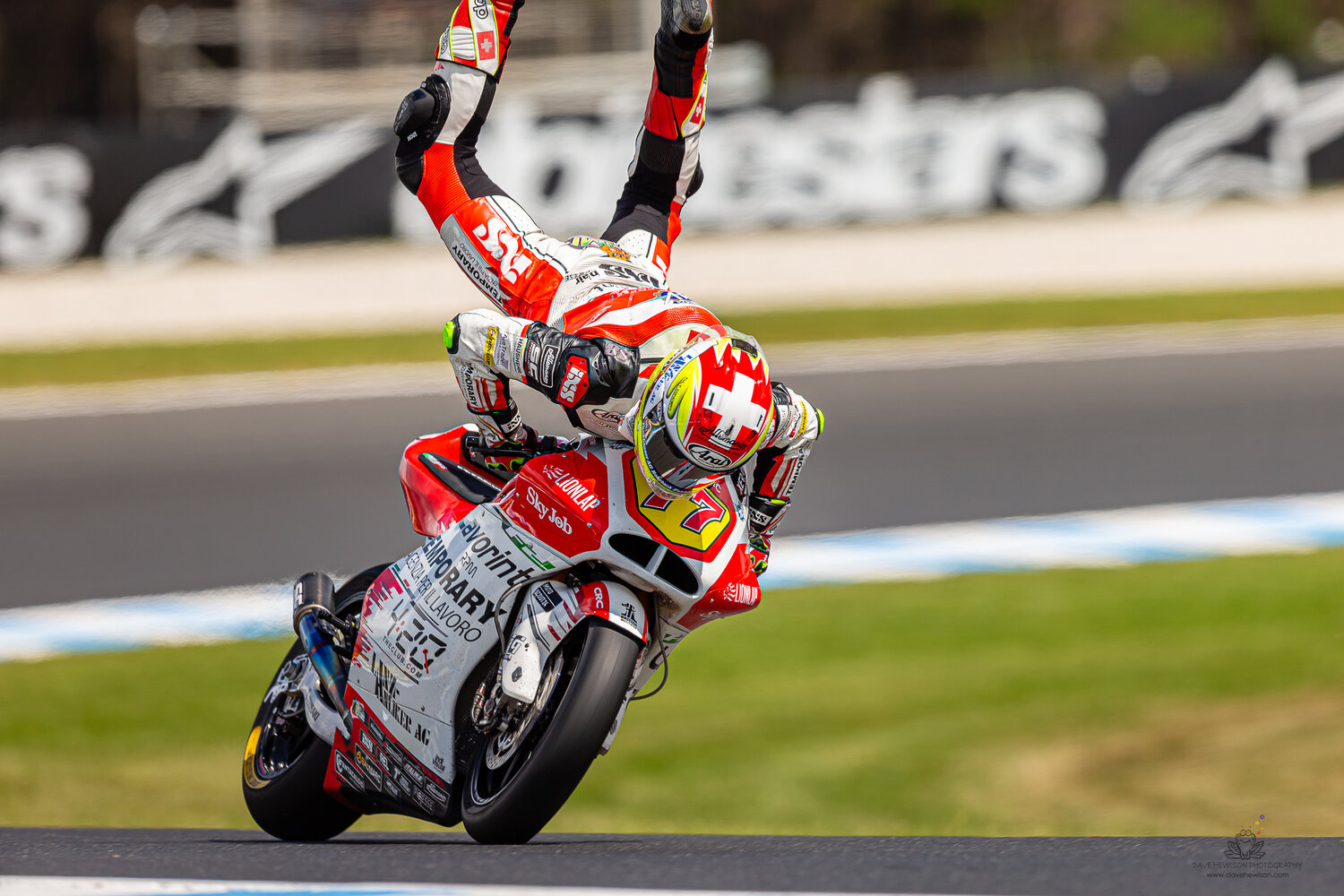 Phillip Island, Australia. 26 October, 2019. Dominique Aegerter (77) riding for Forward Racing Team (CHE) holds on during Free Practice 4 at the Promac Generac Australian MotoGP. Credit: Dave Hewison/Alamy Live News