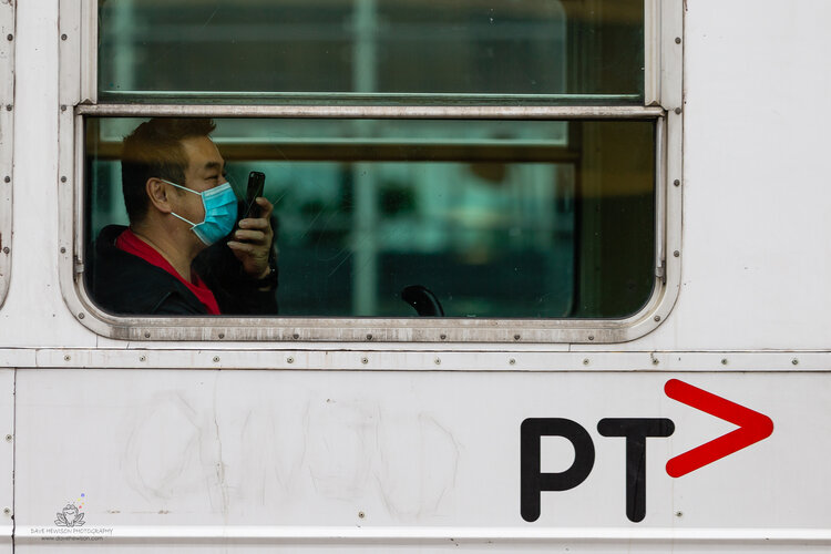 A man wearing a facemask talks on the phone while sitting in an empty tram during COVID 19 on 17 April, 2020 in Melbourne, Australia. (Photo by Speed Media/Icon Sportswire)