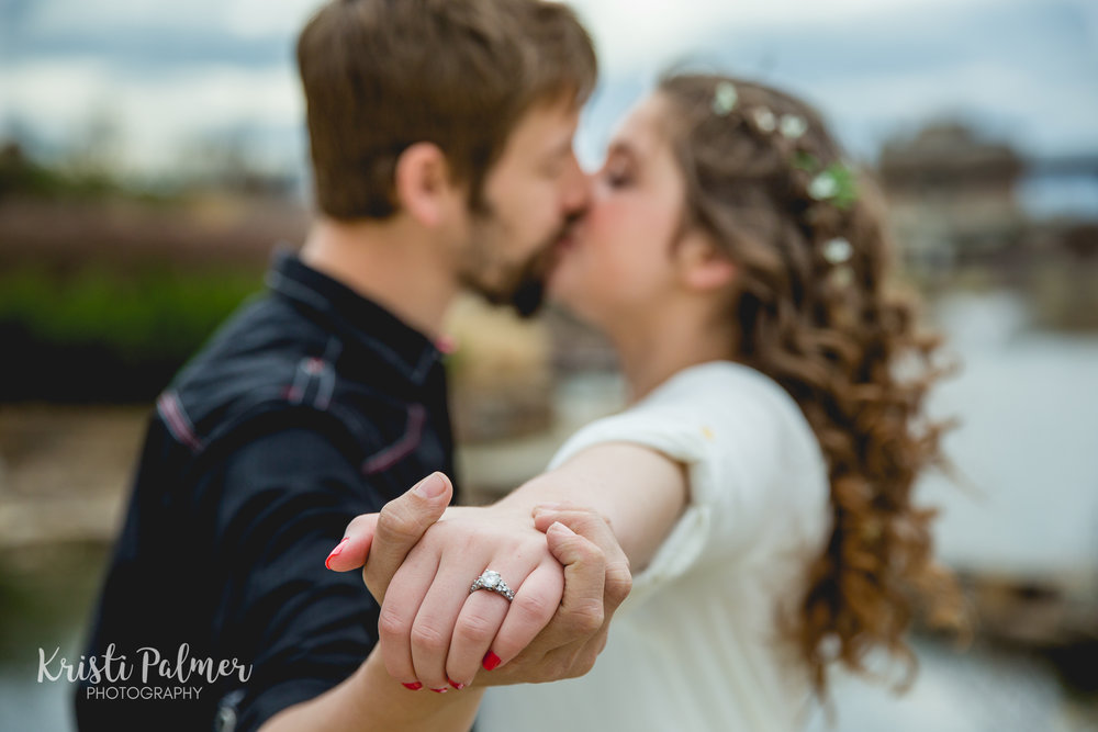 engagement ring and kiss in tulsa oklahoma
