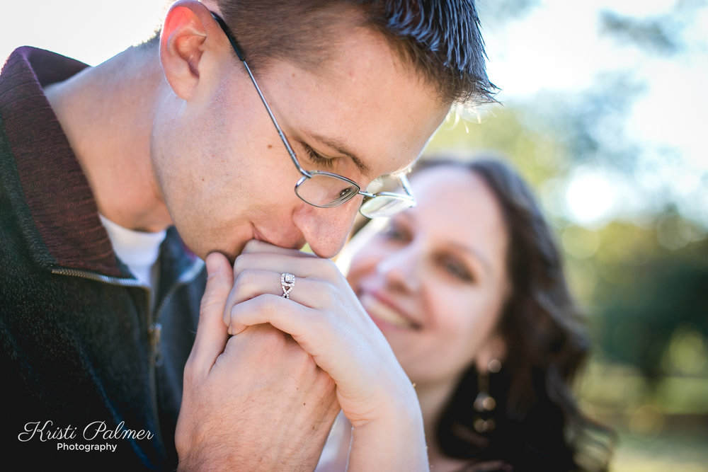 engagement ring kiss portrait
