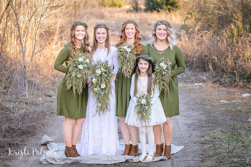 bride with bridesmaids and flower girl bridal party portraits