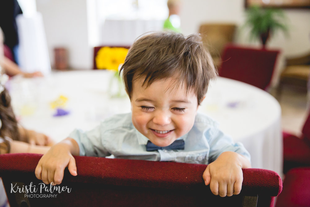 wedding reception laughing toddler boy