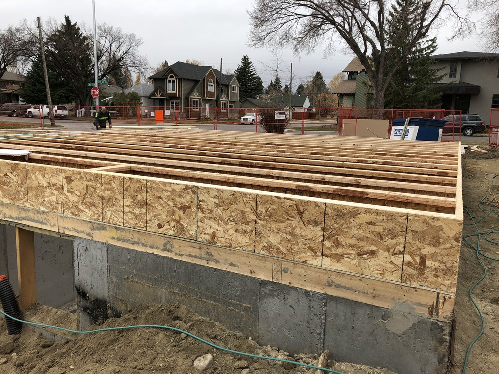 - Framing begins - we have the foundation backfilled and joists being installed at the semi-d project.