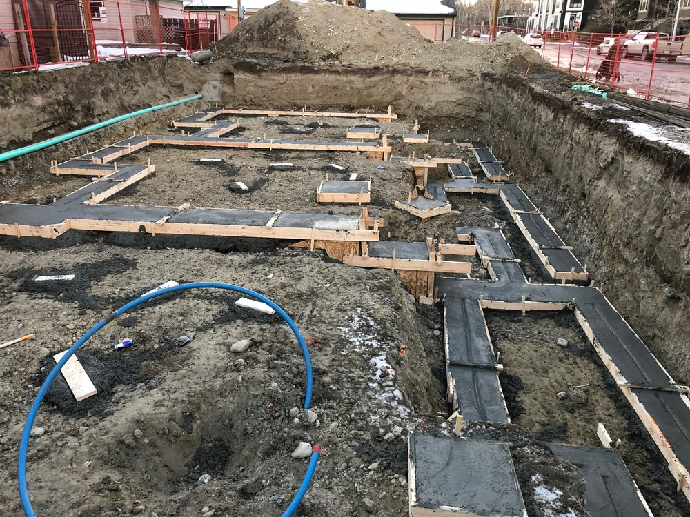 - Rowhouse foundation progress - with the footings poured the cribbers can raise the walls.  This is a large and difficult job that is made significantly worse due to the fire code restrictions imposed on the project.