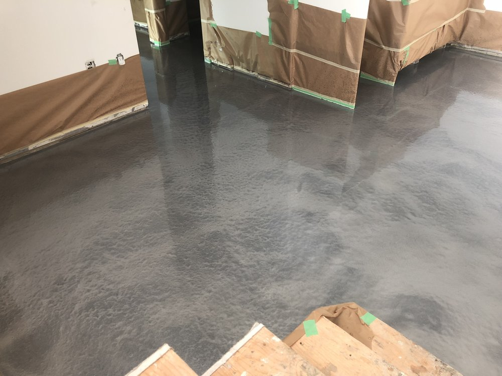 - Semi-detached project - we had a professional crew come in and pour an epoxy floor on the basement slab.