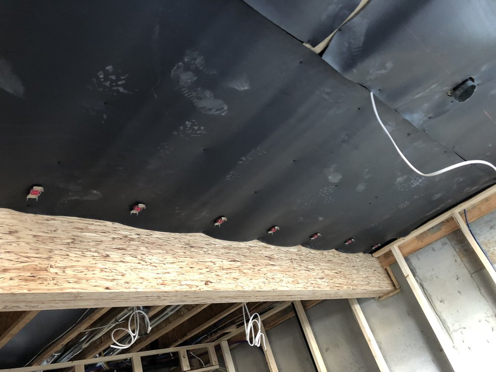 - Rowhouse sound insulation - the mass loaded vinyl sound barrier product is going on at the ceiling of the apartments.