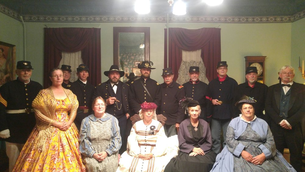 General Grant with some of his men and their ladies. The General is the man with the cigar of course (fourth from the left).