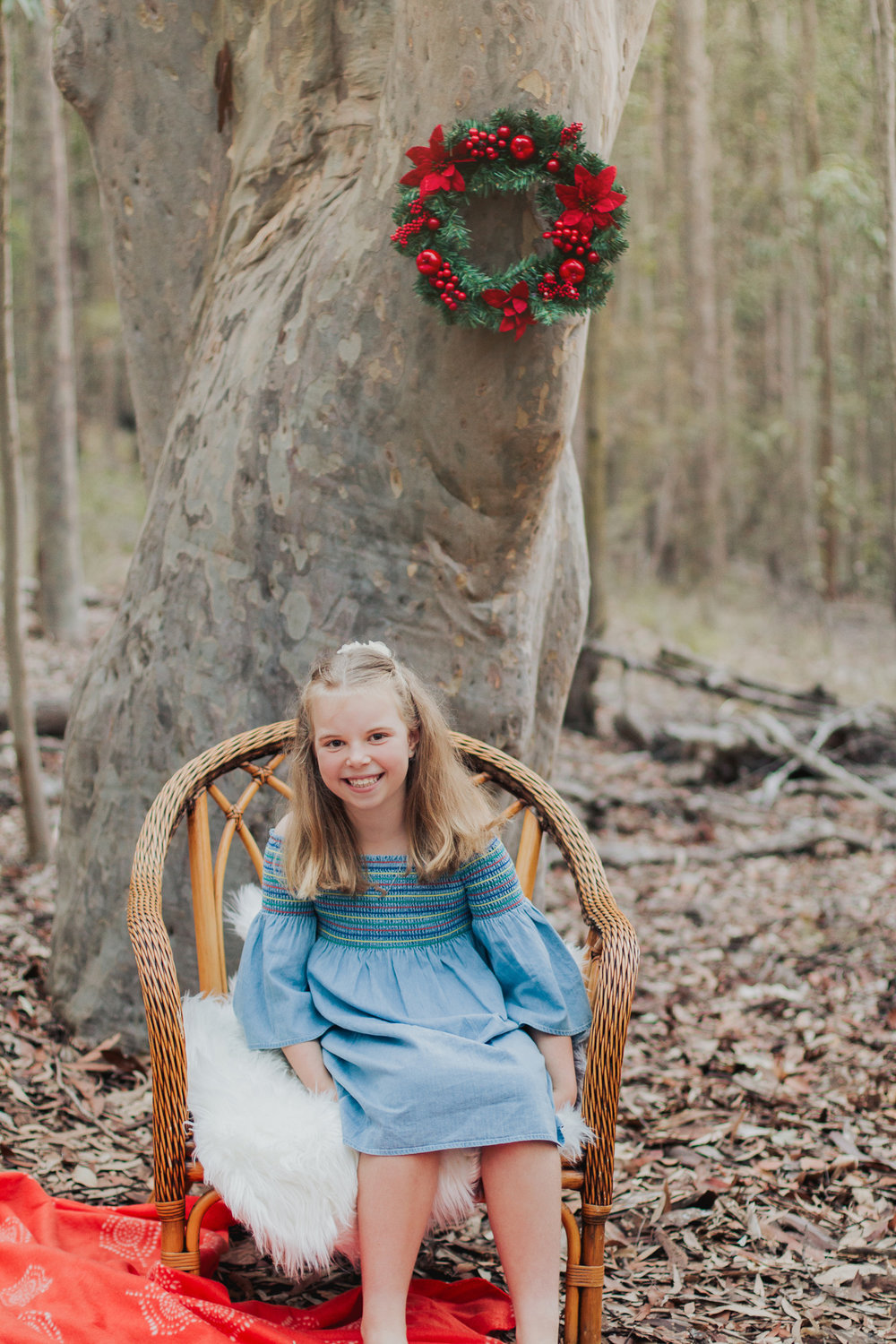 girl-sitting-in-chair-with-wreath
