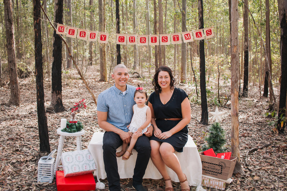 family-of-three-sitting-in-the-bush