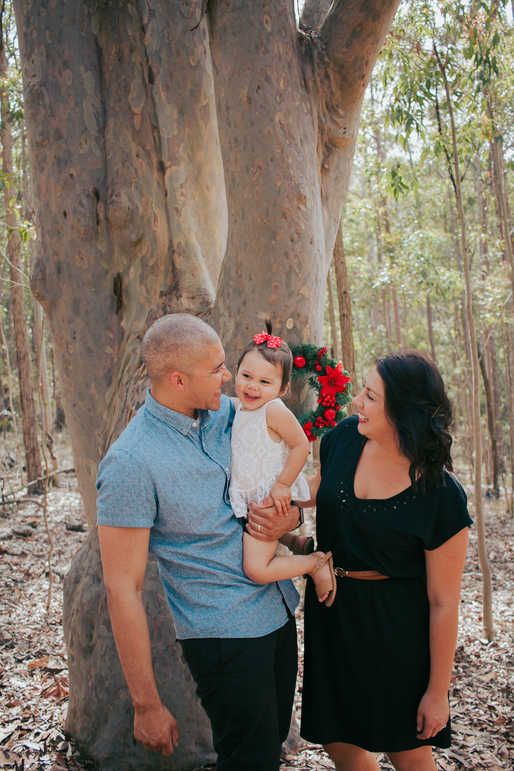 young-family-by-the-tree