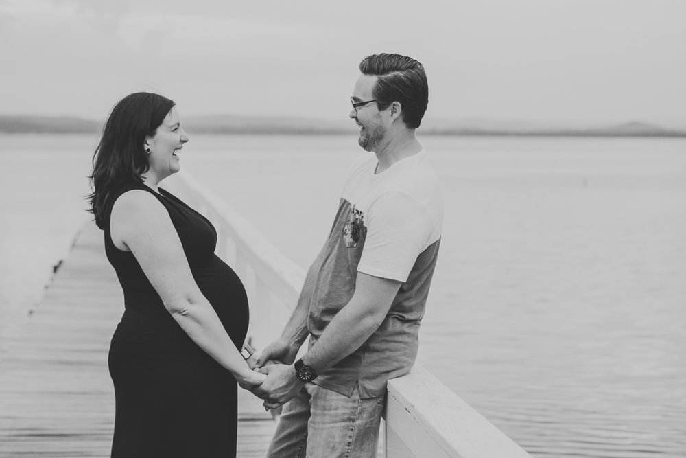 couple on jetty for maternity session on the central coast