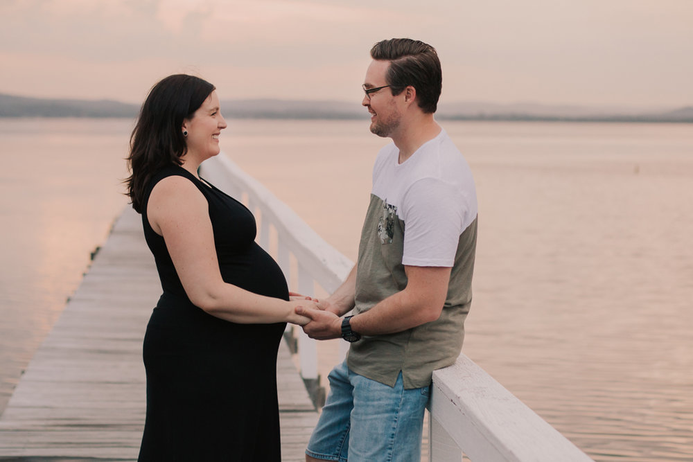 couple holding hands at maternity session