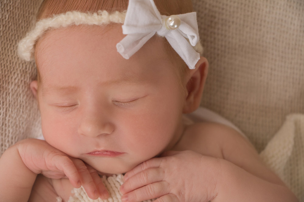 sleeping baby with bow head band
