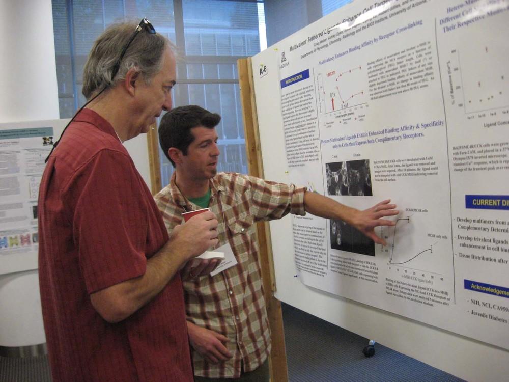 Craig Weber presenting his poster to William Montfort