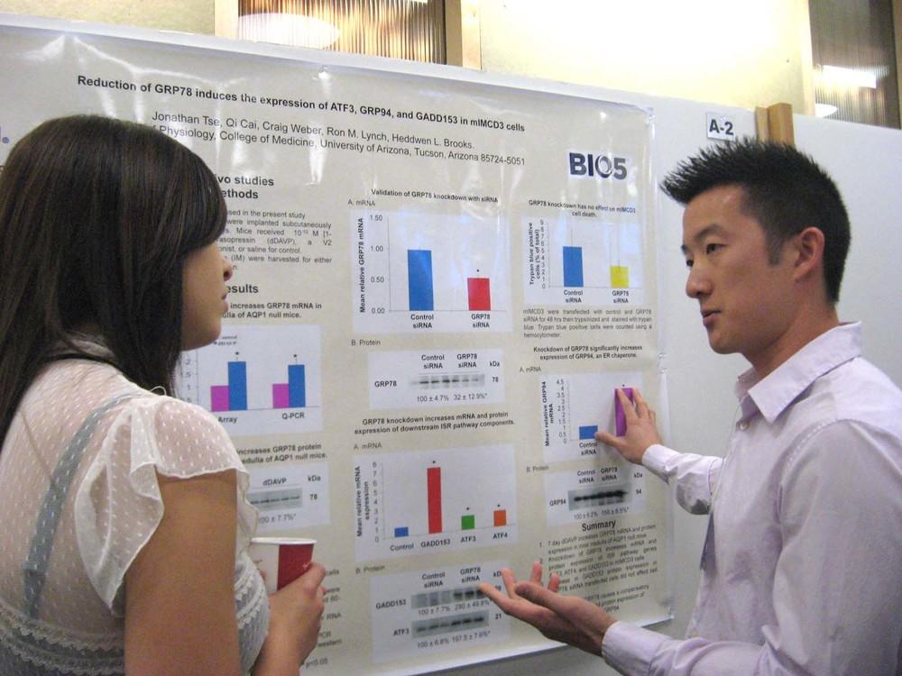 Jon Tse sharing his work with Gabrielle Brown