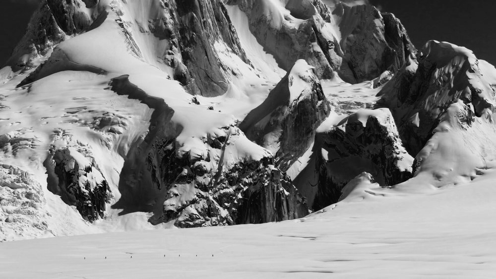 Six Skiers in the Great Gorge beneath the Moose's Tooth.  Ruth Glacier, AK