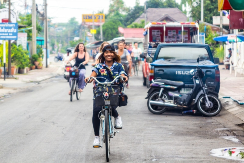 Girl riding on a bicycle in Thailand.