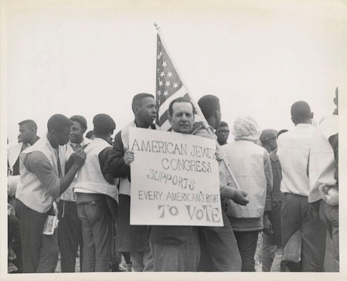 American Jewish Congress member holds sign at Montgomery March, 1965. Photograph, American Jewish Historical Society, 1965.