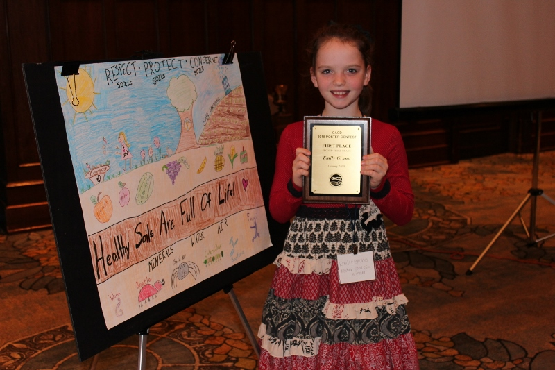 Emilee Gruno with her prize-winning poster