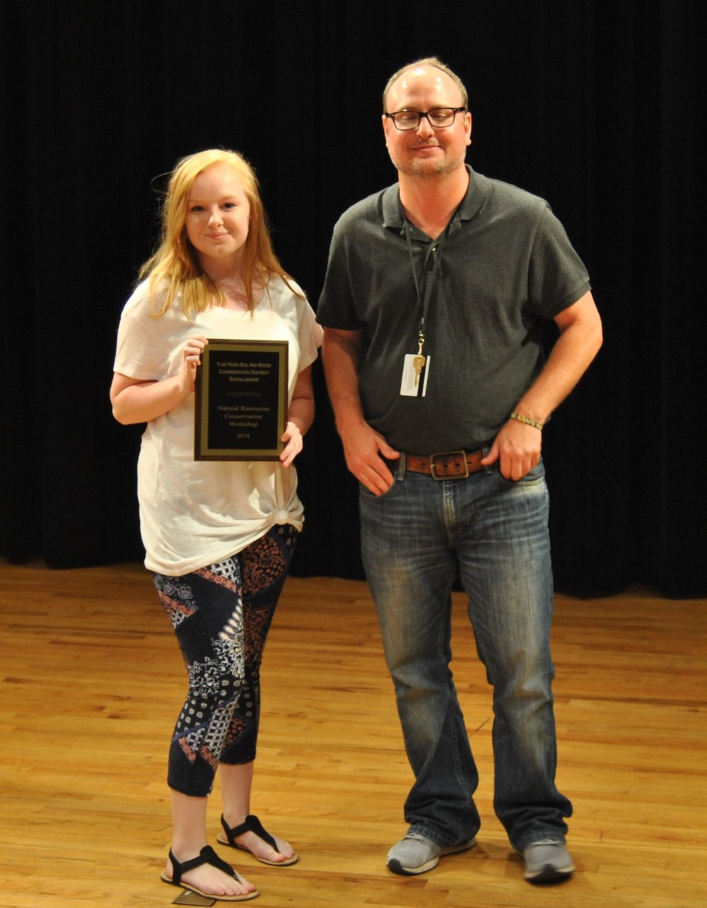 Victoria Edmunds, a rising 12th-grade student at Rockdale County High School, was the recipient of the $500 Flint River Soil and Water Conservation District Scholarship.  Victoria's registration to NRCW was sponsored by the Rockdale County Soil and Water Conservation District. Pictured with Victoria is NRCW Director Luke Crosson.