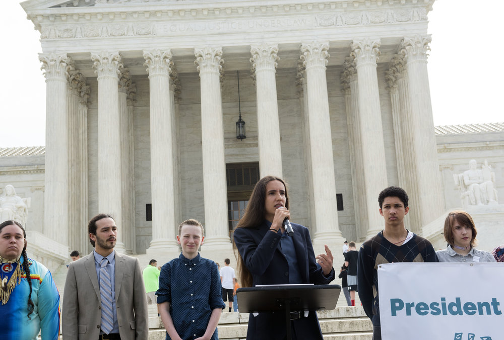 Xiuhtezcatl speaks outside the US Supreme Court, April 27, 2017. Photo: Robin Loznak