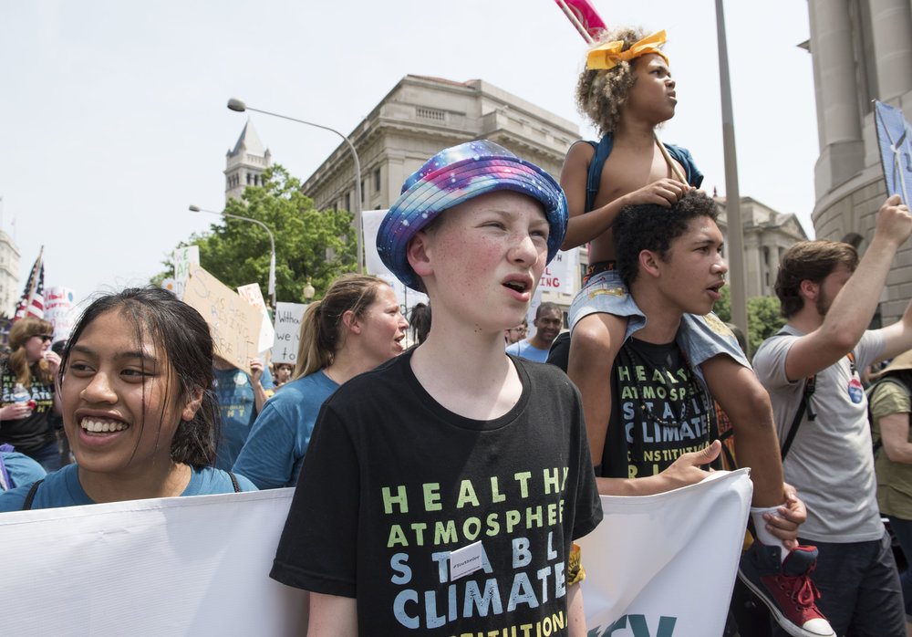 Zealand marches at the People's Climate March in Washington D.C. on April 29, 2017 with his fellow #youthvgov plaintiffs. Photo: Robin Loznak