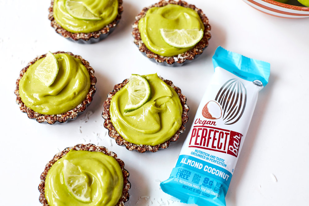 VEGAN AVOCADO LIME TARTS WITH PERFECT BAR ALMOND COCONUT CRUST