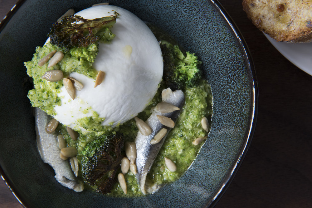 maplebrook buratta   broccoli pesto  .  white  . anchovies  . sunflower . toast