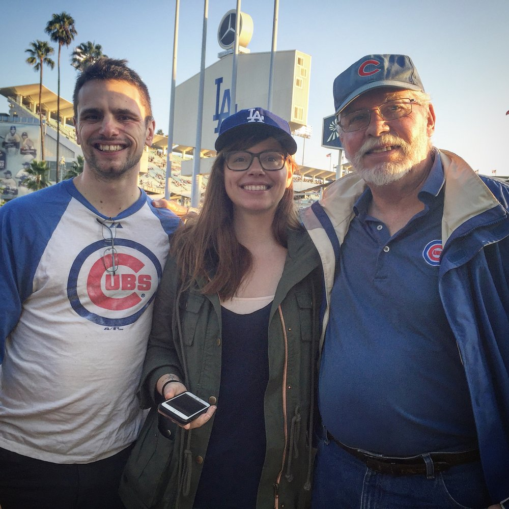 The Manis's rooting for the Cubs at Dodger Stadium.