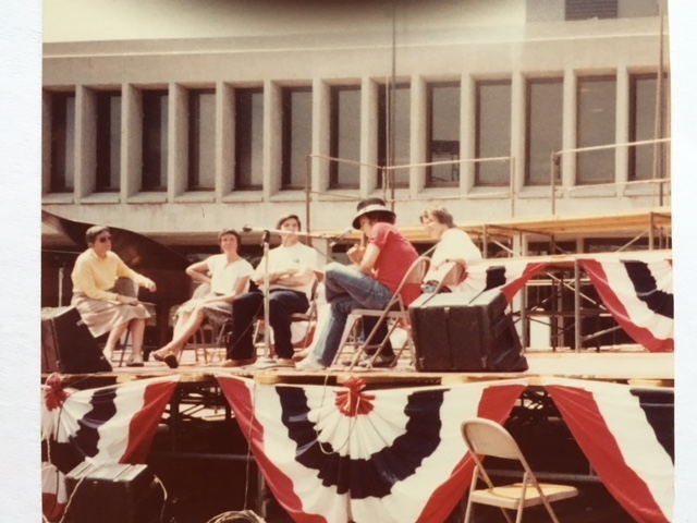Reading with regional writers on JFK Plaza, Lowell City Hall, at the 1981 Lowell Festival