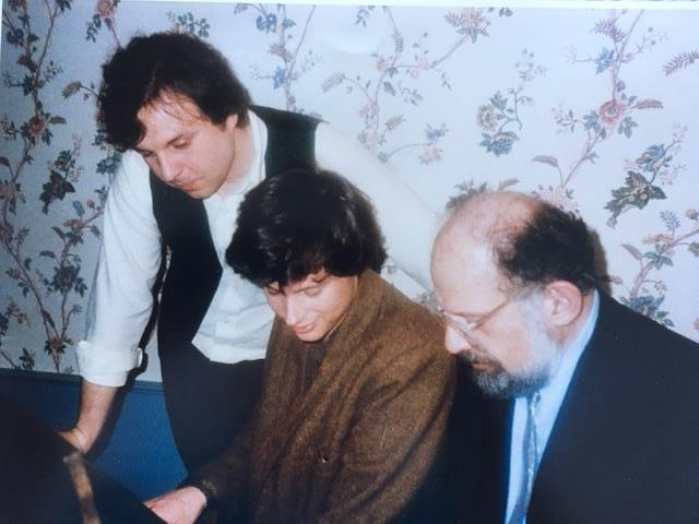 """Allen Ginsberg, right, with George Chigas, center, and me at the piano in the home of former Lowell City Manager William Taupier and family in Lowell following a poetry reading with Allen, Gregory Corso and writers from the community. The event at Liberty Hall/Merrimack Repertory Theater was a benefit for the new Jack Kerouac literary organization in Lowell on Monday, March 17, 1986, St. Patrick's Day evening. George and Allen are playing a tune while Allen sings a song from his long poem """"Contest of the Bards."""" He sang the lines and his collaborators repeated them all the way through. (The photographer may have been George's wife, Thida Leoung.)"""