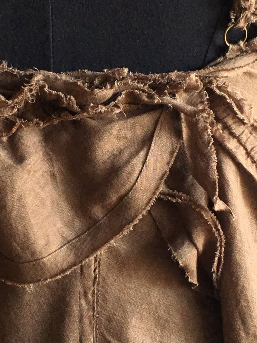 front ruffle close-up brown dress.jpg