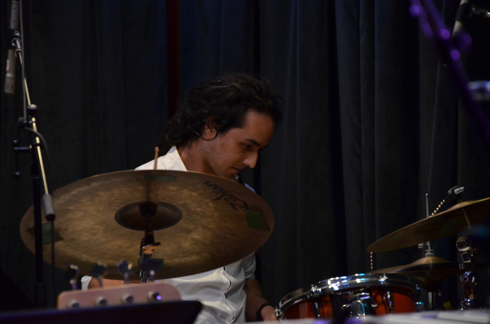 Juan Mejia-Drums and Percussion - Juan Mejia hails from Bogota, colombia. In NYC he was given a diploma in drum set performance at the Collective School of Music, where he studied with amazing musicians such as Peter Retzlaff, Vince Cherico, Ian Froman, Pat Petrillo, Jason Gianni, Bob Quaranta, Marko Djordjevic, Kim Plainfield, Sean Conly, Maciek Schejbal, Sean Conly and Adriano Santos. Also, while studying he played in many NYC renowned jazz clubs, such as Cafe Wah (where Bob Dylan and Jimi Hendrix played historical concerts) and Lic Bar.On scholarship at Berklee, Juan is studying, besides music theory and ear training, Performance, Contemporary Writing and Production and he is doing a minor in Performance studies in latin music. His mentors have been Ian Froman, Casey Scheuerell, Kim Plainfield, Mark Walker, Henrique De Almeida, Neal Smith and Dave Dicenso. He has played a vast amount of concerts from his very first semester, playing everything from pop music to jazz, funk to latin and playing both percussion and drum set. He has also recorded in all of the Berklee recording studios, film scoring studios and outside Berklee studios such us at the record company, Studio one and Perfection.