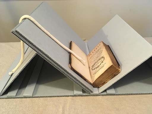 Image of a collapsable book cradle with additional spacer boards to provide more spine support.