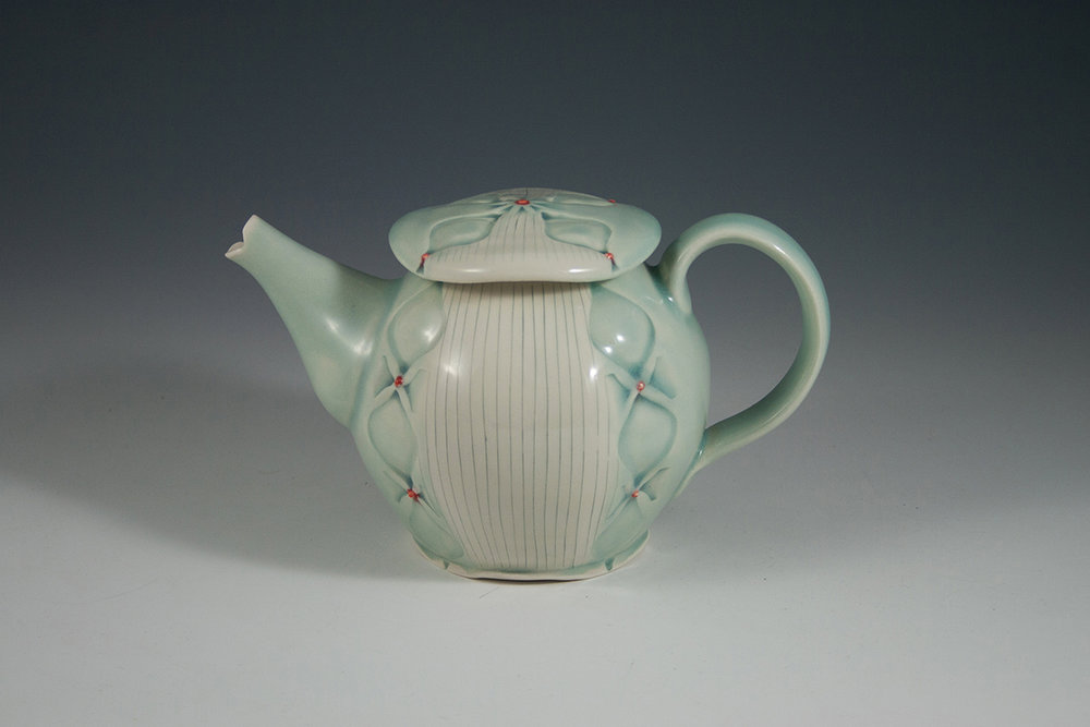 Teapot 2016, Stamped and inlaid porcelain, cone 6 electric