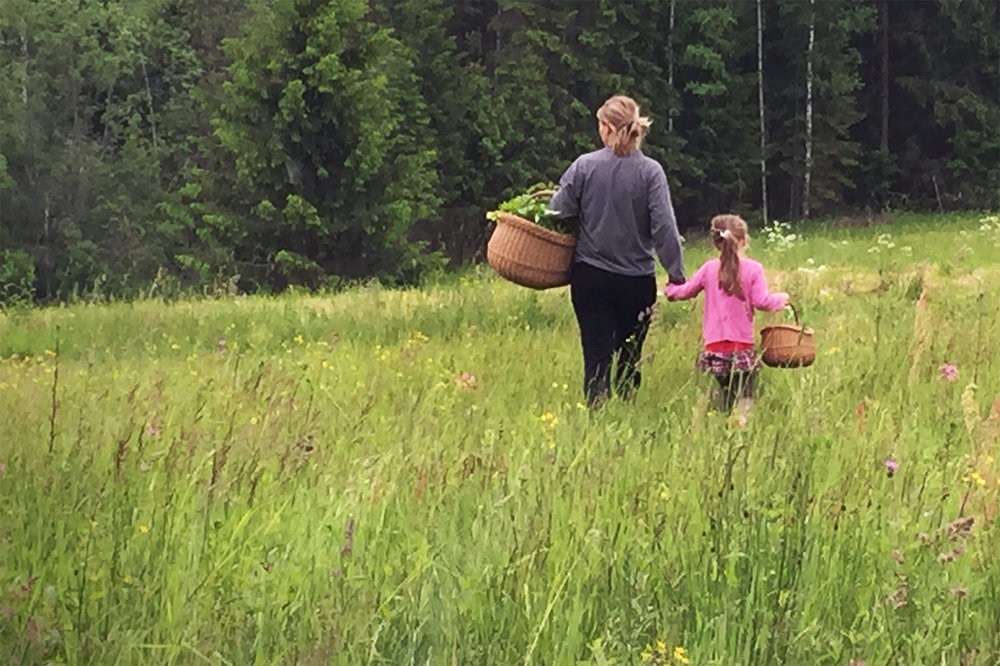 Evita Lukina and her daughter Lote foraging for berries.
