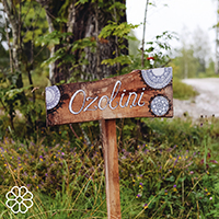 The welcome sign on Ozolini farm in Latvia