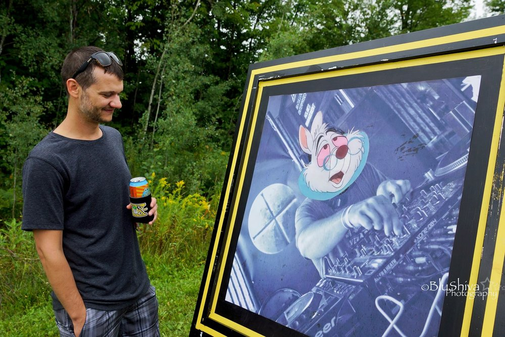 Ryan Motta with his one of his photos. Photo courtesy Shannon Crabtree.