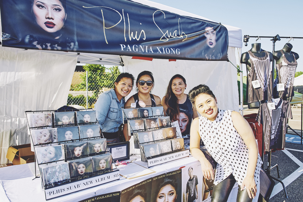 Plhis Suab booth with the sister crew.