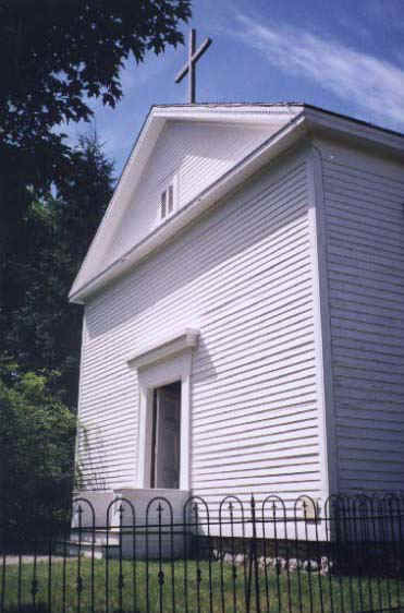 Pictured here is the original church of our parish, originally named St. Fechan's. The parish began as a mission in 1855 to serve the growing number of Catholic families in Chili. Father Murphy became in charge of the parish in 1954, and was instrumental in moving the parish to the Chili Avenue location. You can still visit this church building, as it currently resides at the Genesee Country Museum!